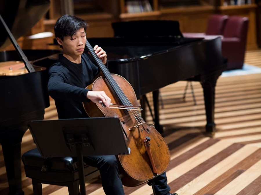 Student performs cello in Chancellor Green
