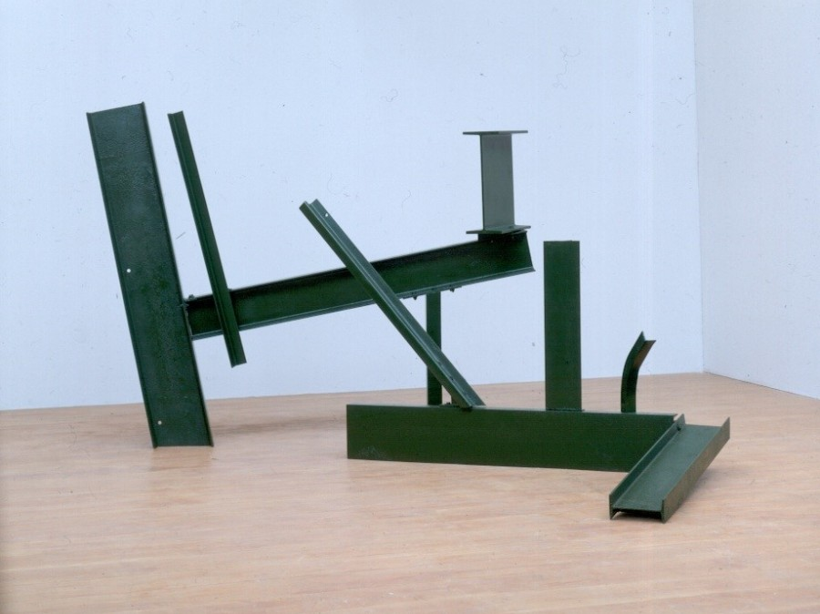 Anthony Caro Sculpture Two from 1962 featuring place metal I-Beams in green on museum floor