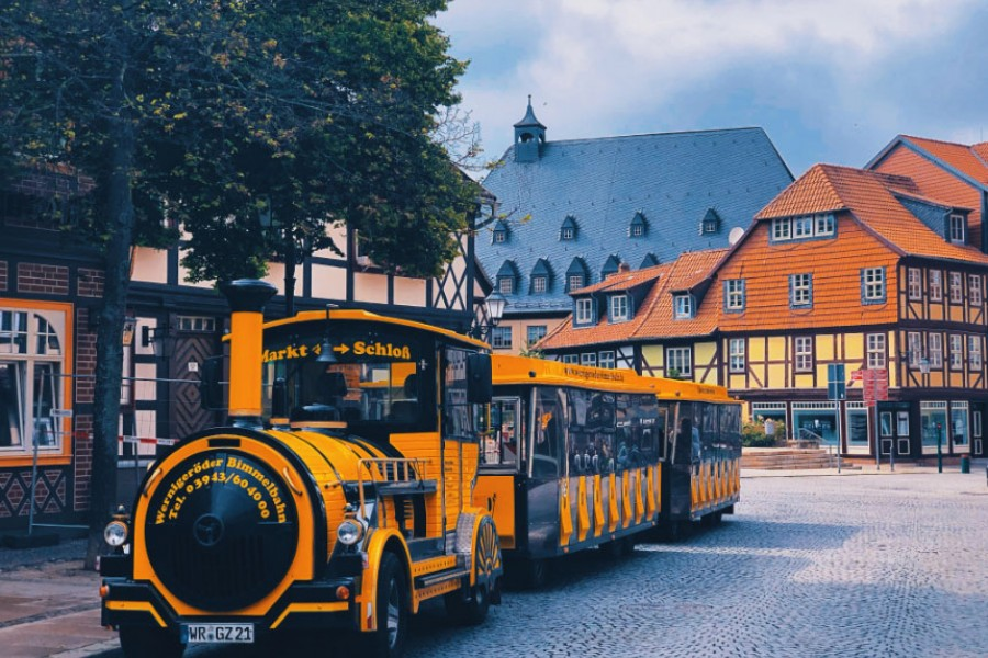 Tram resembling an old train, carrying tourists through old Quedlinburg