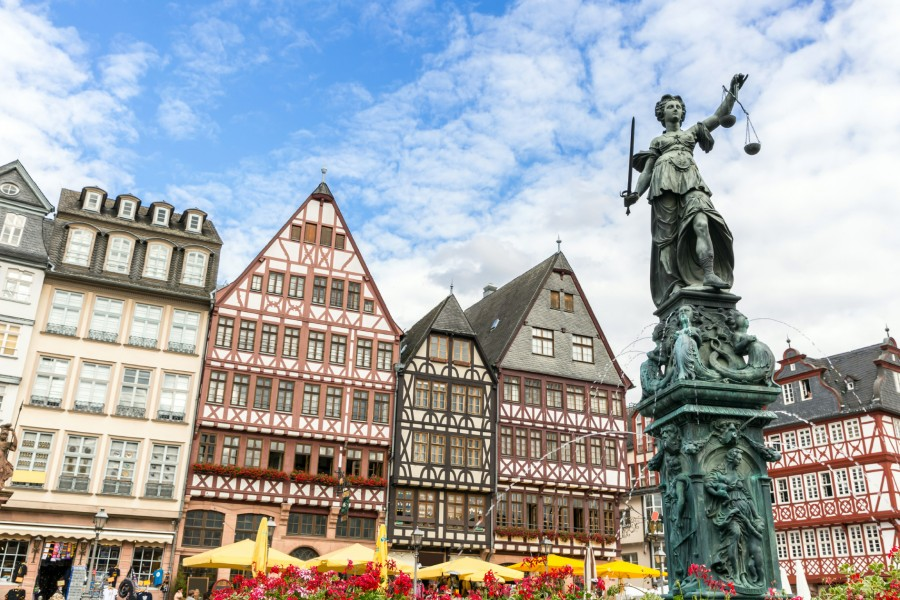 Romerburg Town Square with statue in foreground in Frankfurt Germany